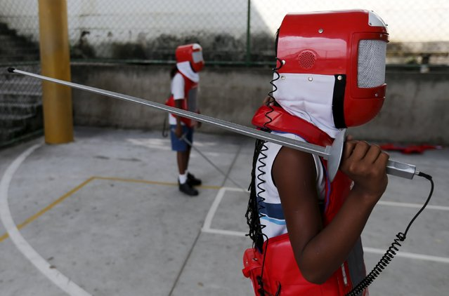 "A child, from Municipal school Parana, poses during the project ""Fencing School"" in Rio de Janeiro, Brazil, March 30, 2016. (Photo by Sergio Moraes/Reuters)"
