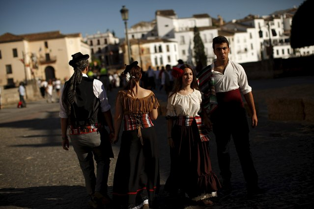 "Couples dressed as bandits walk as they participate in the third edition of ""Ronda Romantica"" (Romantic Ronda) in Ronda, southern Spain, May 16, 2015. (Photo by Jon Nazca/Reuters)"