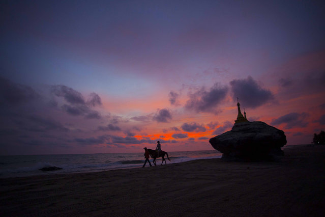 In this May 16, 2015, photo, a visitor rides a horse near pagodas at Ngwe Saung beach, Pathein township, about 145 miles from Yangon, Myanmar. (Photo by Khin Maung Win/AP Photo)