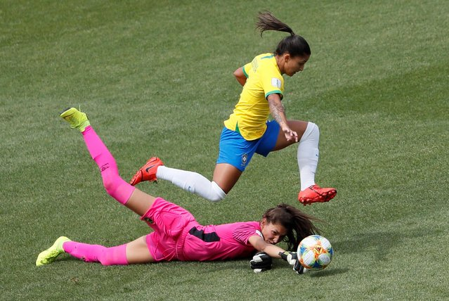 Brazil's forward Debinha (up) vies with Jamaica's goalkeeper Sydney Schneider during the France 2019 Women's World Cup Group C football match between Brazil and Jamaica on June 9, 2019, at the Alpes Stadium in Grenoble, central-eastern France. (Photo by Emmanuel Foudrot/Reuters)