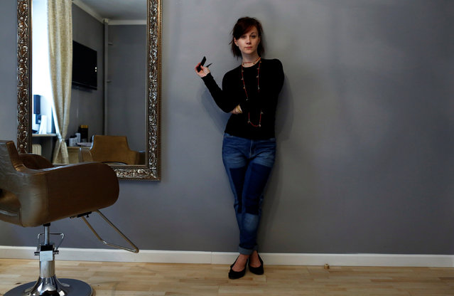 """Aneta Lukasiewicz, 33, a hairdresser, poses for a photograph at a hairdressing studio in Warsaw, Poland, February 23, 2017. """"From my observation in this job there are more women hairdressers then men in Poland. But I think the number of male hairdressers is growing. From my experience women clients even prefer to have their hair cut by men, sometimes the reason is curiosity, but also it's a fashion"""". (Photo by Kacper Pempel/Reuters)"""