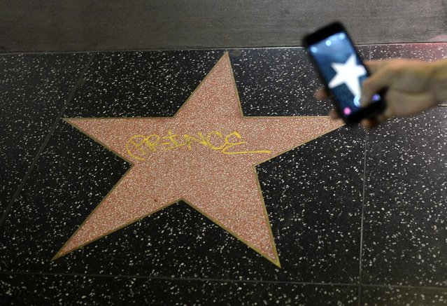 A Hollywood Walk of fame star with a graffiti of musician Prince is seen on Hollywood Boulevard in memory of legendary singer on April 21, 2016, in Los Angeles, California. (Photo by Kevork Djansezian/Getty Images)