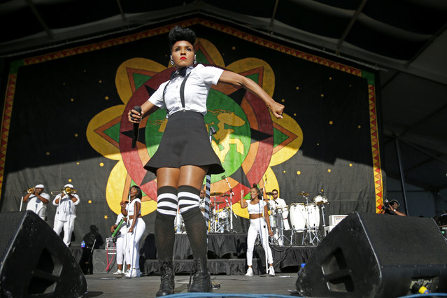 Janelle Monae performs at the New Orleans Jazz and Heritage Festival in New Orleans, Friday, April 22, 2016. Monae, who had a professional working relationship with Prince, who died yesterday, said onstage she was dedicating her show to him. (Photo by Gerald Herbert/AP Photo)