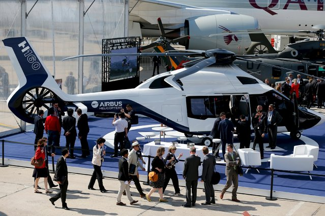 Visitors look at A H160 of Airbus Helicopter on display during the 51st Paris Air Show at Le Bourget airport near Paris June 17, 2015. REUTERS/Pascal Rossignol