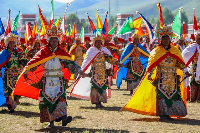 Tibetan people gather to celebrate the opening ceremony of the annual Qinghai Yushu Horse Racing Festival in the Yushu Tibetan Autonomous Prefecture, China on July 25, 2019. The Qinghai Yushu Horse Racing Festival is a traditional festival that was held during the week of July 25 – August 1 every year. (Photo by Imaginechina/Rex Features/Shutterstock)