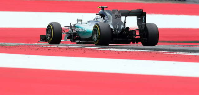 Mercedes driver Nico Rosberg of Germany steers his car during the Austrian Formula One Grand Prix race in Spielberg, southern Austria, Sunday, June 21, 2015. (AP Photo/Ronald Zak)