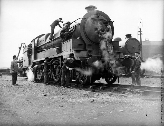 1932: Cleaning the express locomotive 'Earl Haig' at the Neasden loco sheds of the LNER (London and North Eastern Railway)