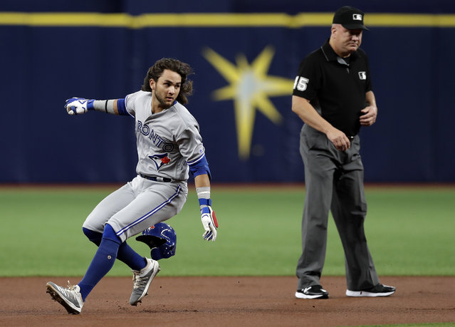 Toronto Blue Jays' Bo Bichette loses his helmet overunning second base after hitting a double off Tampa Bay Rays starting pitcher Charlie Morton during the first inning of a baseball game Monday, August 5, 2019, in St. Petersburg, Fla. (Photo by Chris O'Meara/AP Photo)