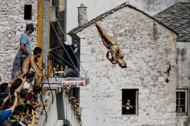 In this handout image provided by Red Bull, Jacqueline Valente of Brazil dives from the 21 metre platform on Stari Most during the first training session of the sixth stop of the Red Bull Cliff Diving World Series on August 22, 2019 at Mostar, Bosnia and Herzegovina. (Photo by Dean Treml/Red Bull via Getty Images)