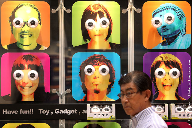 A visitor walks past Cube Co., Ltd's toy eyeballs 'Nikodama' displayed during the International Tokyo Toy Show 2010