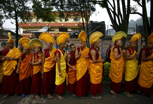 Tibetan monks take part in a function organized to mark the 80th birthday celebrations of Dalai Lama in Kathmandu July 6, 2015. (Photo by Navesh Chitrakar/Reuters)