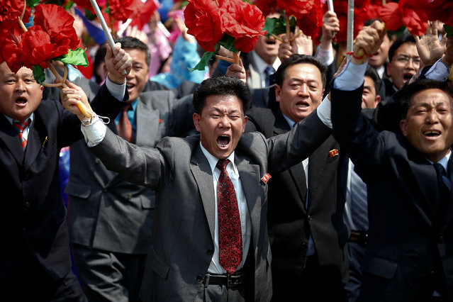 People react as they march past the stand with North Korean leader Kim Jong Un during a military parade marking the 105th birth anniversary of the country's founding father Kim Il Sung, in Pyongyang April 15, 2017. (Photo by Damir Sagolj/Reuters)