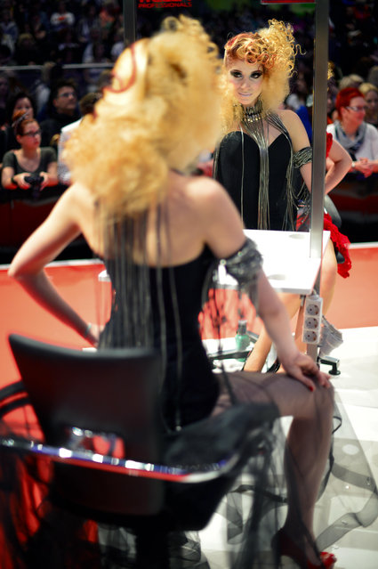 """A Model styled by a participant waits to be judged by the jury during the contest """"Day style"""" of the OMC Hairworld World Cup on May 4, 2014 in Frankfurt am Main, Germany. (Photo by Thomas Lohnes/Getty Images)"""