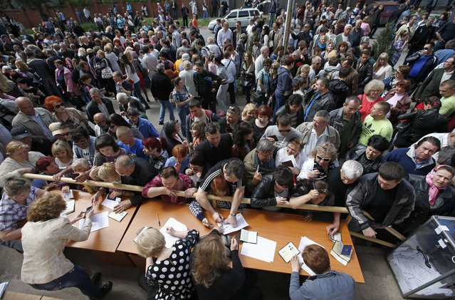 In the eastern Ukrainian city of Mariupol, voters wait to receive ballots from members of the local election commission, on May 11, 2014. (Photo by Marko Djurica/Reuters)