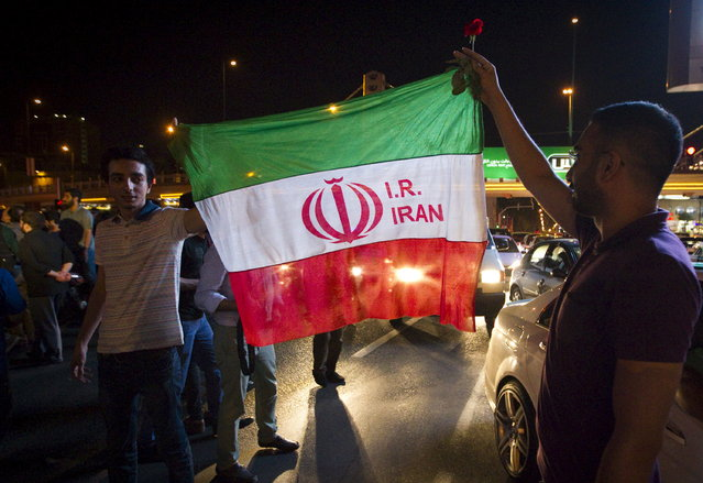 Iranians celebrate on the streets following a nuclear deal with major powers, in Tehran July 14, 2015. (Photo by Reuters/TIMA)