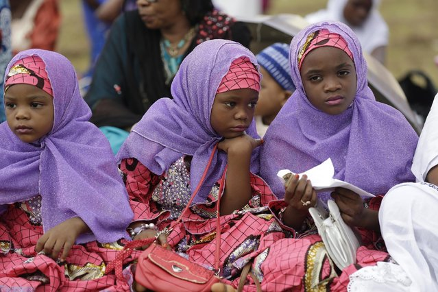 Nigeria Muslim girls attend Eid al-Fitr prayer, marking the end of the Muslim holy fasting month of Ramadan in Lagos, Nigeria, Friday, July 17, 2015. (Photo by Sunday Alamba/AP Photo)
