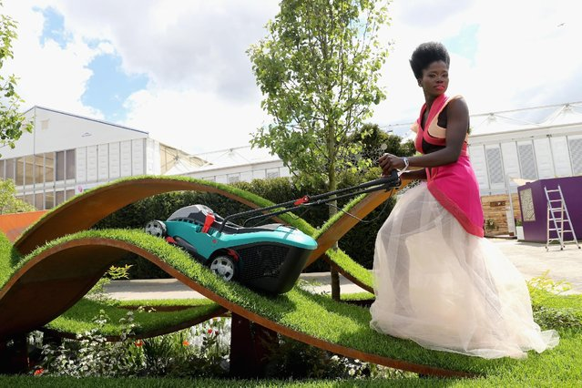 A model with a lawnmower at RHS Chelsea Flower Show on May 23, 2016 in London, England. (Photo by Chris Jackson/Getty Images)