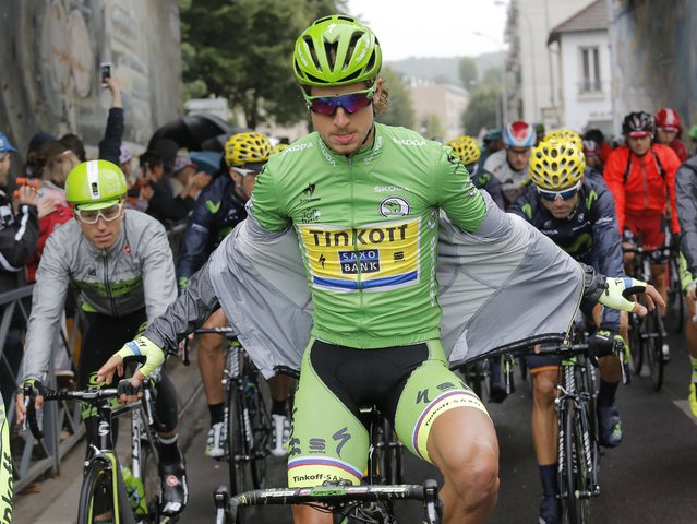 Peter Sagan of Slovakia, wearing the best sprinter's jersey cycles at the start of the twenty-first and last stage of the Tour de France cycling race over 109.5 kilometers (68 miles) with start in Sevres and finish in Paris, France, Sunday, July 26, 2015. (Photo by Laurent Cipriani/AP Photo)