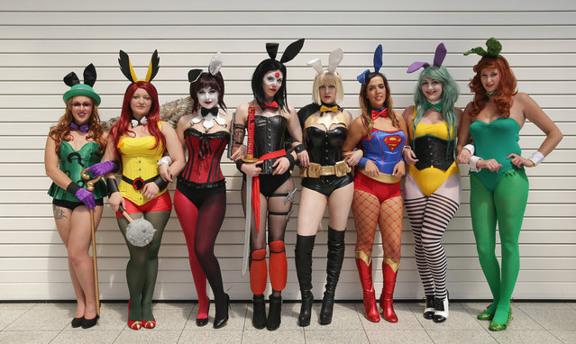 "(L-R) Megan as ""Riddler"", Amber-as ""Hawkgirl"", Anastasia, as ""Harley Quinn"", Jadene as ""Katana"", Katie as ""Batgirl"", Rebecca as ""Supergirl"", Chloe as ""Joker"", and Katie as ""Poison Ivy"" from the DC cosplay bunnies, pose together for a photograph on the second day of the London ""MCM Comic Con"" at the ExCel centre in east London, on May 27, 2017. The comic convention is the largest of it's type in the UK and sees fans and enthusiasts flock to the ExCel centre to meet their heros, browse merchandise and see previews of upcoming releases. (Photo by Daniel Leal-Olivas/AFP Photo)"