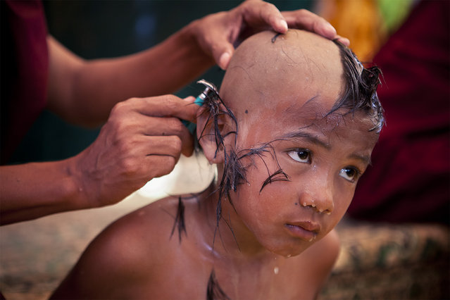 """""""Boy becomes monk"""". A young boy undergoes the ceremony to become a monk in Bagan. Photo location: Myanmar. (Photo and caption by Marcelo Salvador/National Geographic Photo Contest)"""