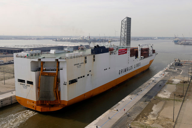 """A cargo ship crosses the world's biggest lock """"Kieldrechtsluis"""" during its inauguaration at Belgium's port of Antwerp, June 10, 2016. Picture taken through a window. (Photo by Francois Lenoir/Reuters)"""