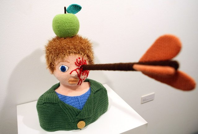 The knitted sculpture 'William Tell' by Patricia Waller sits in the 'Broken Heroes' exhibition at the Deschler Gallery