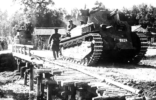 A Japanese tank passes over an emergency bridge, somewhere in China, on June 30, 1941
