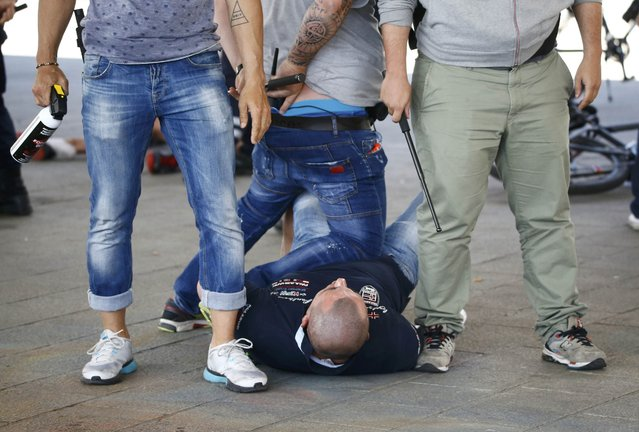 Football Soccer, EURO 2016, Marseille, France on June 21, 2016. Poland fans are detained by police at the old port of Marseille, France.     REUTERS/Wolfgang Rattay