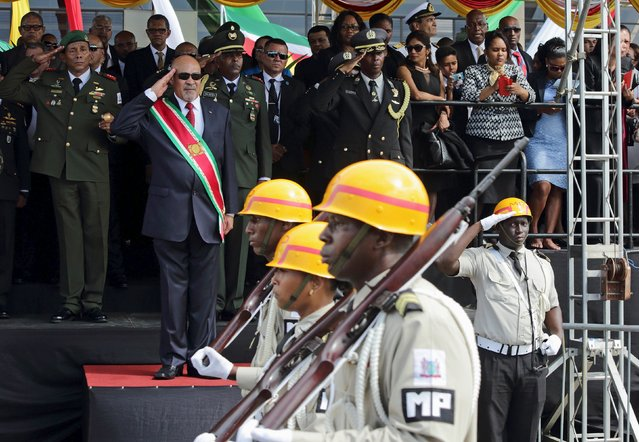 Suriname's President Desi Bouterse salutes during a military parade following his swearing in to a second consecutive term of office in Paramaribo, Suriname, August 12, 2015. (Photo by Ranu Abhelakh/Reuters)