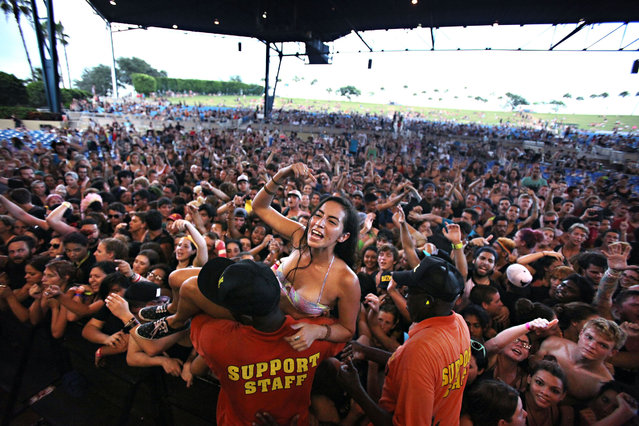 Crowd surfers enjoy the pop punk band The Story So Far during the Vans Warped Tour at the Cruzan Amphitheatre in West Palm Beach on July 26, 2014. (Photo by Richard Graulich/The Palm Beach Post)