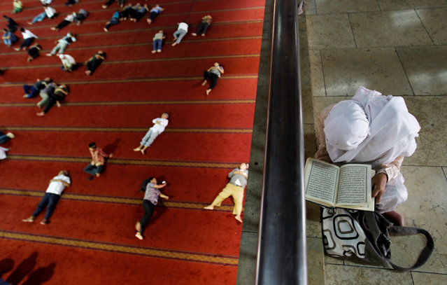 A Muslim woman reads the Koran inside Istiqlal mosque during the holy fasting month of Ramadan in Jakarta, Indonesia  July 1, 2016. (Photo by Iqro Rinaldi/Reuters)