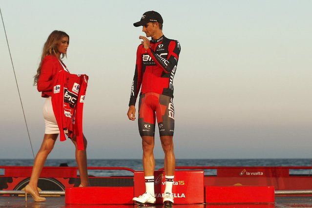 BMC Racing Team rider Peter Velits of Slovakia stands on the podium before wearing the leader's red jersey after winning along with his team the 7.4 km (4.6 miles) team time trial in the first stage of the Vuelta Tour of Spain cycling race from Puerto Banus to Marbella, in Marbella, southern Spain, August 22, 2015. (Photo by Jon Nazca/Reuters)