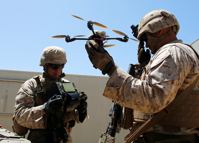 U.S. Marines deploy a Grp I UAS : Instant Eye drone as part of a Rim of the Pacific (RIMPAC) 2016 exercise held at Camp Pendleton, California United States, July 13, 2016. (Photo by Mike Blake/Reuters)