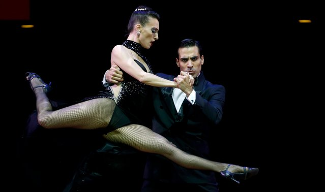 Ruben Barbadori (R) and Debora Maria Agudo from Argentina, who are representing the city of Monte Grande, dance during the Stage style final round at the Tango World Championship in Buenos Aires, Argentina, August 27, 2015. (Photo by Marcos Brindicci/Reuters)