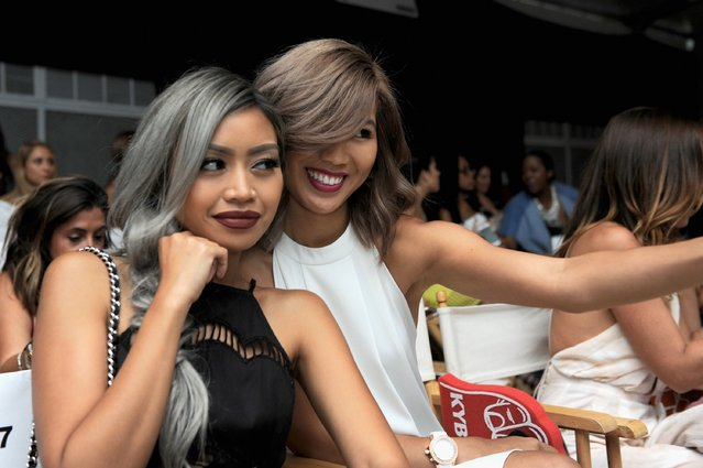 Pau Dictado (L) and Lisa Linh pose at the KYBOE! Watches Miami Swim Week fashion show on July 15, 2016 in Miami Beach, Florida. (Photo by Sergi Alexander/Getty Images for KYBOE!)