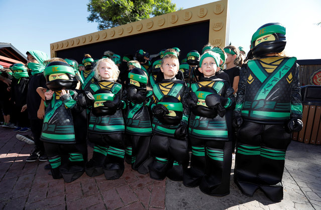 Children dressed as Ninja characters wait before a photocall at Legoland California in Carlsbad, USA on September 14, 2017. (Photo by Mario Anzuoni/Reuters)