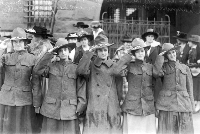 Young women from Lowell in Massachusetts team up to form America's first Women's Death Battalion during World War I, inspired by their Russian counterparts, circa 1917. In front of the armoury where they drill are Mary Tully, Nina Hosington, Blanche Chengnon, Marie Provencher and Agnes Kelley. (Photo by Topical Press Agency/Hulton Archive)