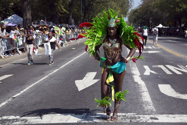 A participant pauses during the West Indian Day Parade in Brooklyn, New York September 7, 2015. (Photo by Andrew Kelly/Reuters)