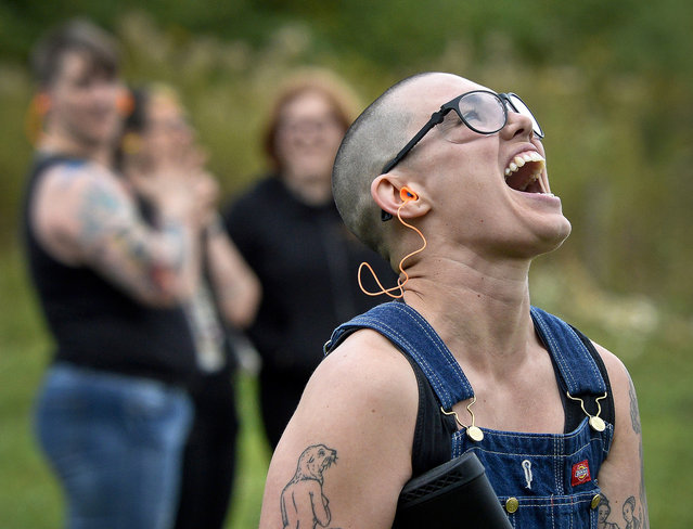 In this October 8, 2017, photo, Emily Lynch reacts to hitting her first clay target during a training session for the Trigger Warning Queer & Trans Gun Club in Victor, N.Y. A gay, lesbian and transgender group concerned that extremists have become more emboldened and dangerous have decided to take up arms. The gun club meets once a month to shoot long guns in a field in upstate New York. (Photo by Adrian Kraus/AP Photo)