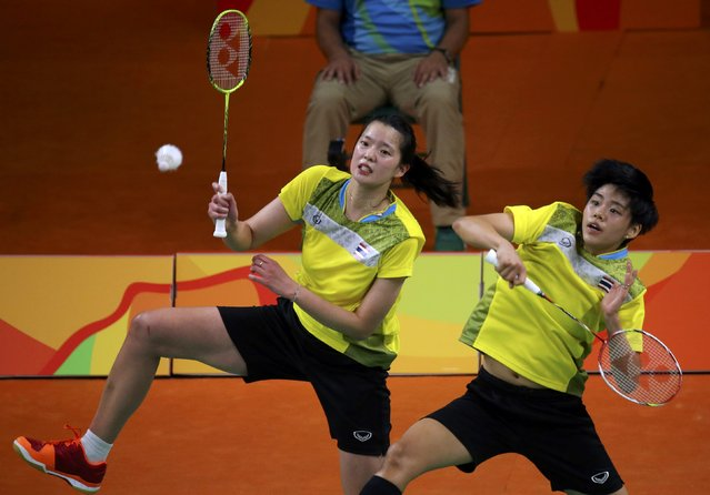 2016 Rio Olympics, Badminton, Women's Doubles Group Play, Riocentro, Pavilion 4, Rio de Janeiro, Brazil on August 12, 2016. Sapsiree Taerattanachai (THA) of Thailand and Puttita Supajirakul (THA) of Thailand play against Misaki Matsutomo (JPN) of Japan and Ayaka Takahashi (JPN) of Japan. (Photo by Marcelo Del Pozo/Reuters)