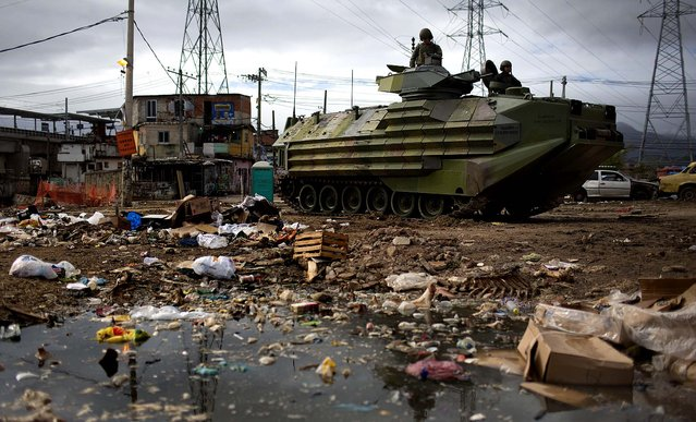 An armored navy vehicle is seen in the Maguinhos slum during an operation to install a Pacifying Police Unit (UPP) in Rio de Janeiro, Brazil, October 14, 2012. (Photo by Felipe Dana/Associated Press)