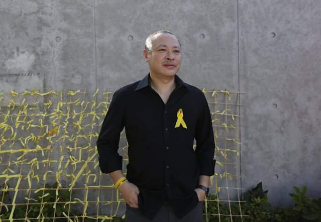 """Benny Tai, 50, one of the founders of the """"Occupy Central"""" civil disobedience movement, poses during a rally in Hong Kong September 26, 2014. Tai said, """"I hope more people will join and hope it will be peaceful"""". (Photo by Bobby Yip/Reuters)"""