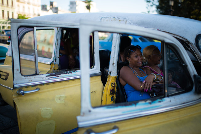 Milagro Cairo Campo, 45, ia pictured in a taxi.  She is heading home from the Old Havana Neighborhood. (Photo by Sarah L. Voisin/The Washington Post)