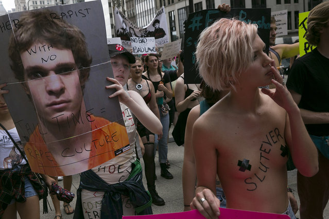 Activists march in downtown Chicago from Cloud Gate in Millennium Park to Watertower along the Magnificent Mile as part of sl*t Walk on August 20, 2016. An international protest against rape culture and victim blaming for sexual assault. (Photo by Rick Majewski/ZUMA Press/Splash News)