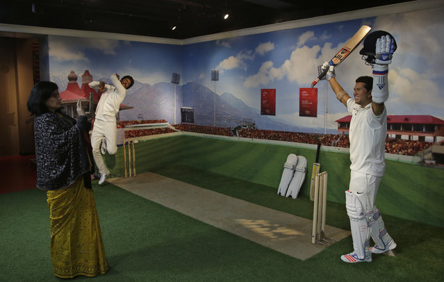 A visitor takes a photograph of a wax figure of former Indian cricketer Sachin Tendulkar during the press preview of Madame Tussauds Wax Museum in New Delhi, India, Thursday, November 30, 2017. (Photo by Altaf Qadri/AP Photo)
