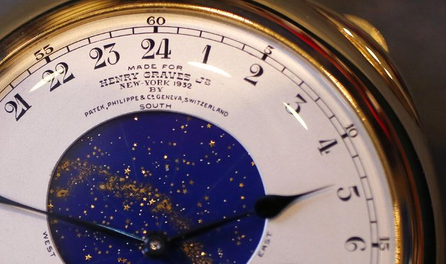 """A celestial sky chart for New York City is seen on the face of """"The Henry Graves Supercomplication"""" handmade watch by Patek Philippe which was completed in 1932 at Sotheby's auction house in London October 21, 2014. (Photo by Suzanne Plunkett/Reuters)"""