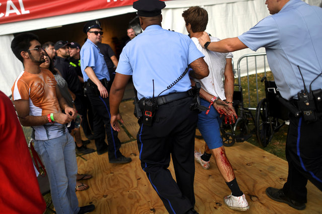 A bloodied man is detained during the fifth annual Made in America Music Festival in Philadelphia, Pennsylvania September 3, 2016. (Photo by Mark Makela/Reuters)