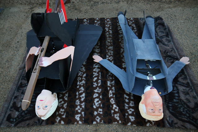 Remote control airplanes in the shape of U.S. Presidential candidates Hillary Clinton and Donald Trump wait to be flown in Carlsbad, California, U.S. September 15, 2016. (Photo by Mike Blake/Reuters)