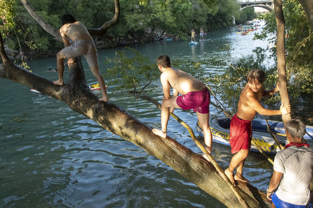 A group of boys cool off in the waters of Barton Creek south of Austin, Texas, US on August 30, 2020. Temperatures hit triple digits and a continued heat wave is expected into September. (Photo by Bob Daemmrich/ZUMA Wire/Rex Features/Shutterstock)