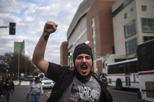 A protester demanding justice for Michael Brown shouts slogans while marching outside the  Edward Jones Dome, the site of the NFL football game between the St. Louis Rams and the Oakland Raiders, in downtown St. Louis, Missouri November 30, 2014. (Photo by Adrees Latif/Reuters)
